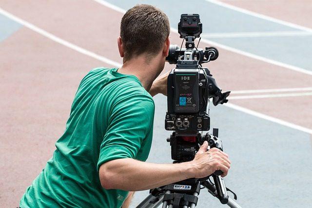 Man filming on set
