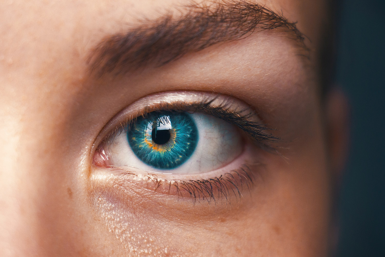 A blue eye of a young woman