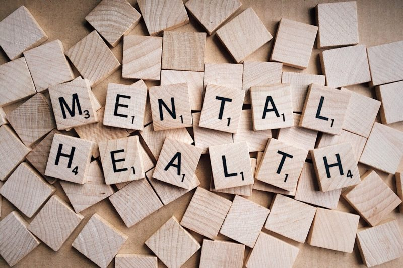 Mental health spelt out amongst wooden scrabble pieces