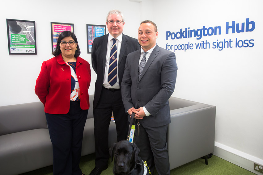 2 men and 1 woman standing together smartly dressed in Pocklington Hub for people with sight loss