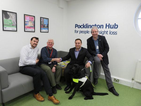 A group of white men sitting on sofa at pocklington hub
