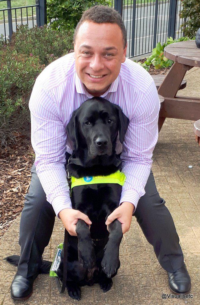 Dan with his black lab guide dog Zodiac