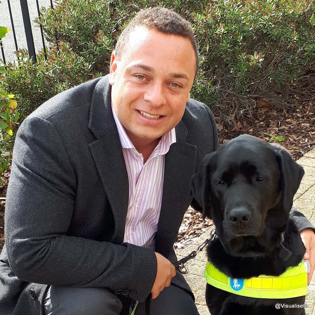 Dan with his arm around trusty guide dog Zodiac