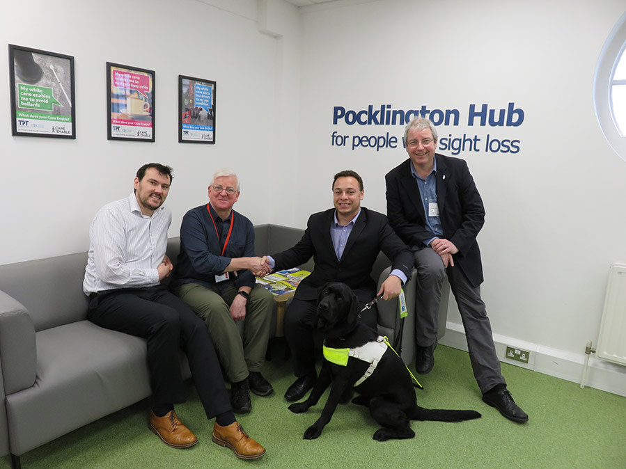 A group of white men sitting on sofa at pocklington hub