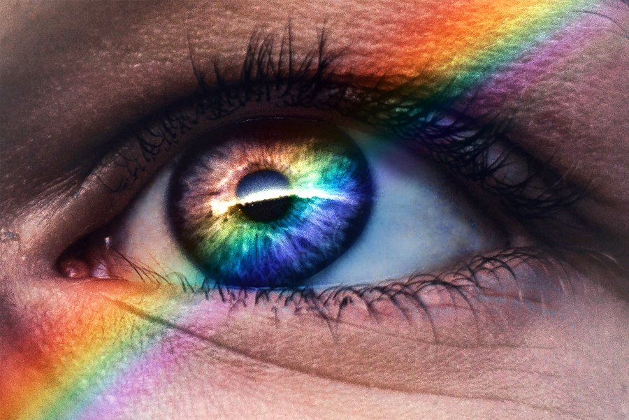 Close up image of an eye with rainbow lights running through it