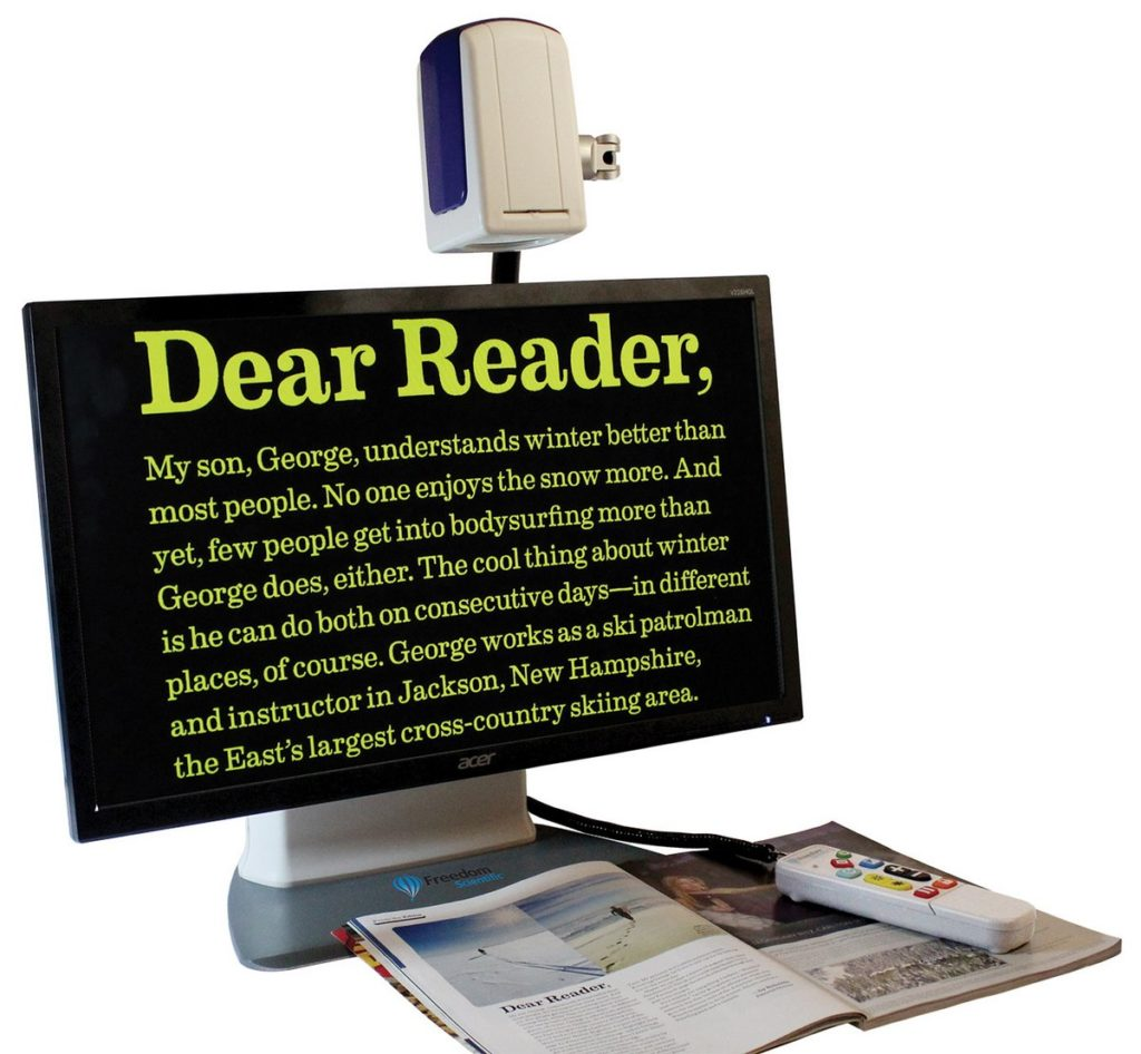 Assistive technology showing hardware that magnifies and transfers text from a printed document to a screen to make it easier for a person with sight loss to read
